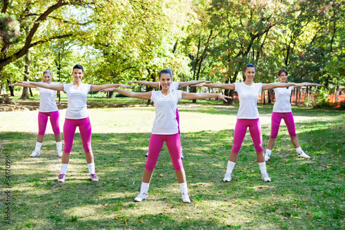 Group of six women doing fitness exercise