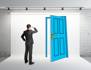 businessman looking at drawing door