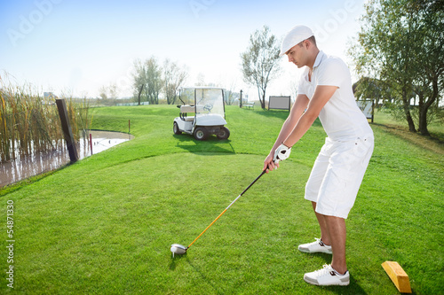 Golfer hitting golf ball