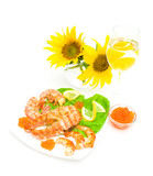 fried fish, shrimp and caviar, a glass of wine and sunflowers on