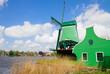dutch  green windmills over  river