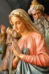 Antique statues of Virgin Mary and a King