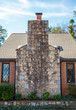 Large Stone Chimney on Small Brick Cottage
