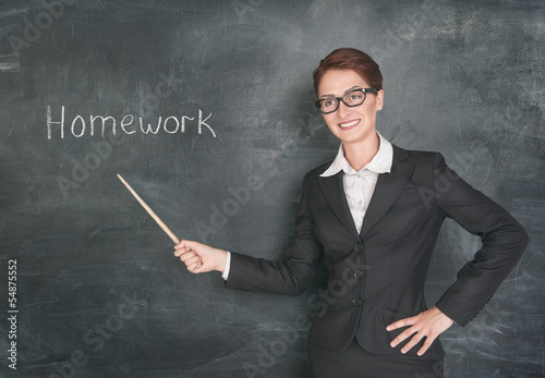 Smiling teacher with pointer and phrase Homework