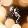 Couple dancing tango in sparkling lights