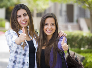 Mixed Race Female Students on School Campus With Thumbs Up