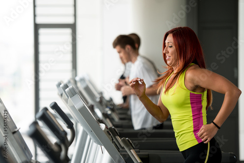 young woman running on treadmills