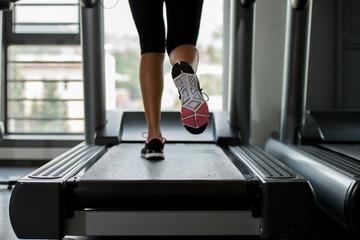 girl running on treadmill