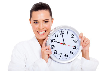 pretty woman holding a clock