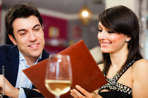 Couple reading a menu