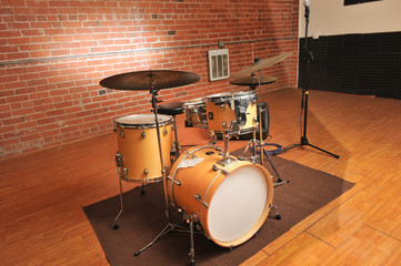 Set of drums in a brick and wood studio
