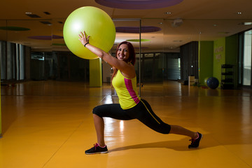 Women stretching with fitness balls