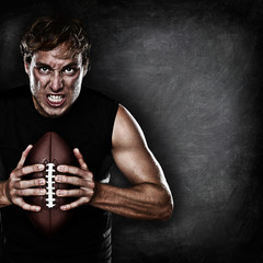 Football player portrait holding american football