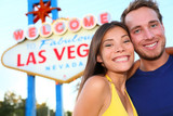 Las Vegas tourist couple at Las Vegas sign