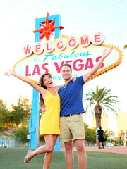 Las Vegas Sign - couple jumping having fun