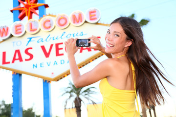 Las Vegas Sign tourist woman happy taking photo