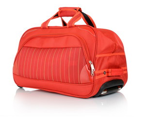 Travel red bag on white background