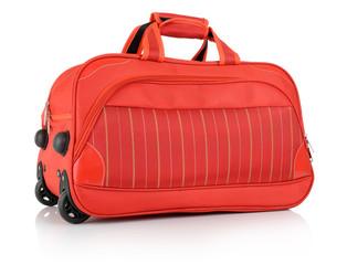 Travel red bag on white background