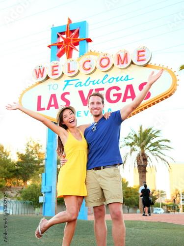 Fototapeta Las Vegas Sign - couple jumping having fun