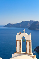 Bell tower above the sea in Santorini