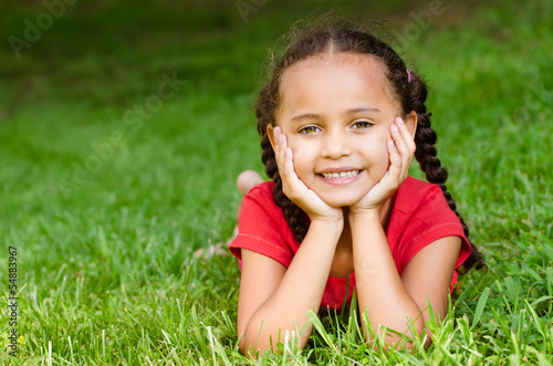Summer portrait of pretty mixed race girl outdoors