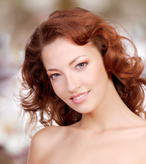 Beatiful woman face with curly hairs