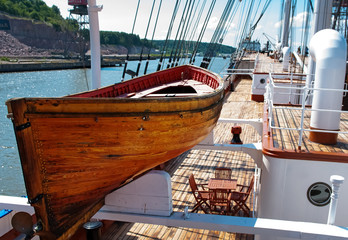 Old wooden lifeboat on the ship