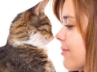 beautiful girl with a kitten's nose-to-nose