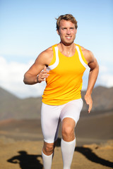 Sport fitness running man sprinting outside