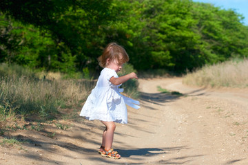 small child in the white dress