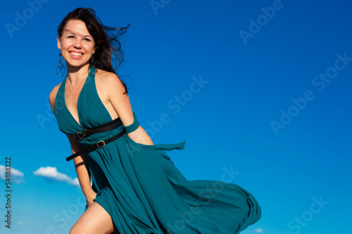 young girl on the beach in beautiful long dress