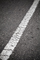 Old white line perspective. Road marking
