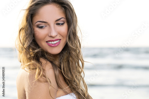 Pretty girl posing near the sea