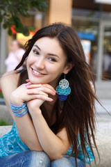Outdoors portrait of beautiful young brunette girl