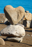 heart of rock with balanced stones, pebbles stacks against blue