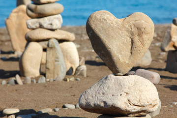 group of balanced stones with rock's heart at front view, pebble