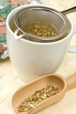 Fennel tee and seeds in a wooden spoon