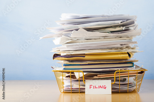Filing Tray Piled High with Documents