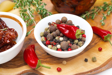 Assorted hot peppers in a bowl and fresh chili peppers