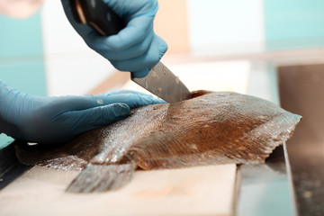 Flatfish getting sliced