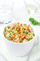 bowl of salad with bulgur, zucchini, tomatoes, chili peppers