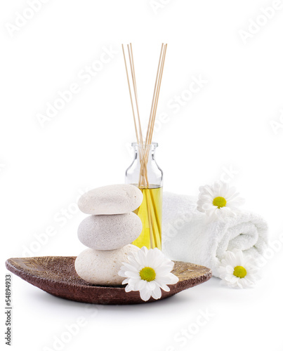 spa decoration with stones, daisies and masssage oil
