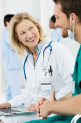Happy Doctor Talking With Surgeon