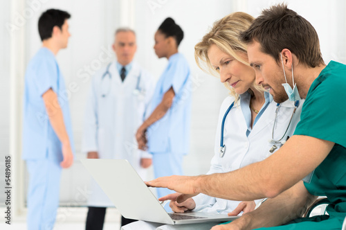 Doctors Working On Laptop