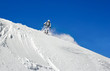 Skier on a background of clear sky
