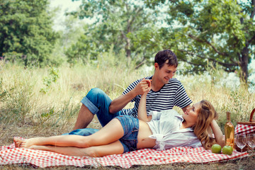 young couple have a rest on picnic, holding hands