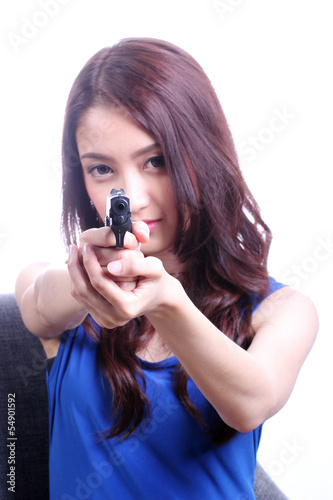 Asian Woman with handgun on white /Selective focus