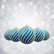 Christmas baubles on white glittery background