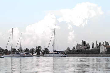 White yachts on an anchor in harbor