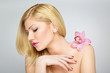 Beautiful young blonde woman wearing sensual floral scent